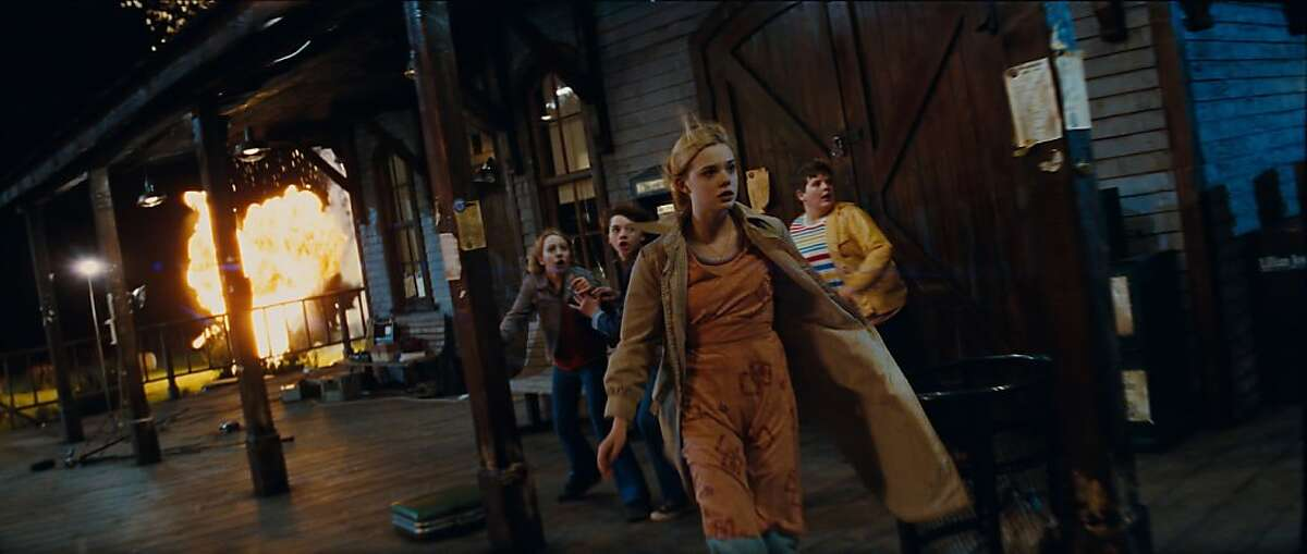 Left to right: Ryan Lee plays Cary, Joel Courtney plays Joe Lamb, Elle Fanning plays Alice Dainard, and Riley Griffiths plays Charles in SUPER 8, from Paramount Pictures.