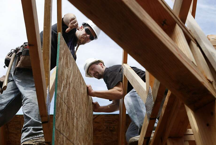 Clinton Gandy working with one of his future neighbors on the roof of what will soon be his family's first owned home in Sebastopol, Calif., on June 11, 2011. Photo: Audrey Whitmeyer-Weathers, The Chronicle