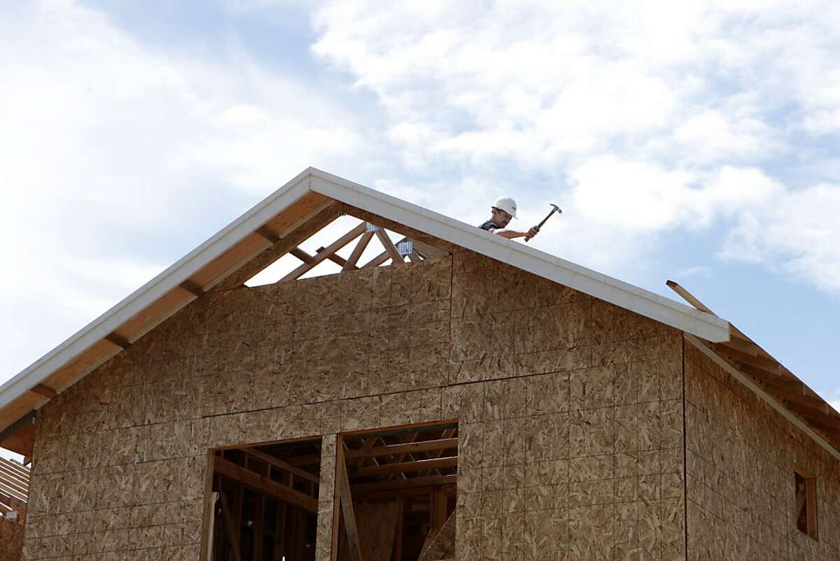 Clinton Gandy working on the roof of what will soon be his family's first owned home in Sebastopol, Calif., on June 11, 2011.