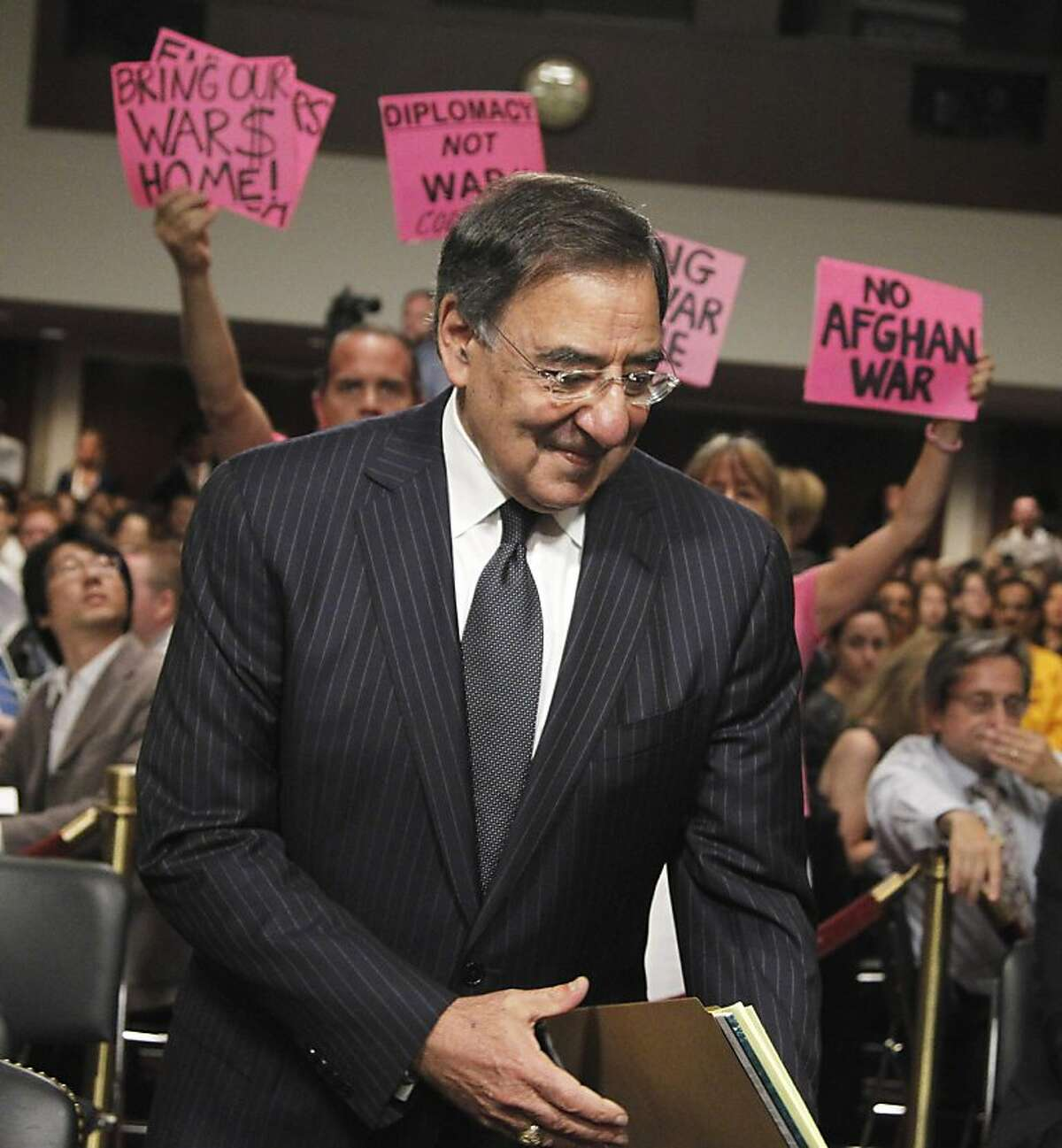 CodePink demonstrators greet Defense Secretary nominee, CIA Director Leon Panetta, as he arrives on Capitol Hill in Washington, Thursday, June 9, 2011, to testify before the Senate Armed Service Committee hearing on his nomination.