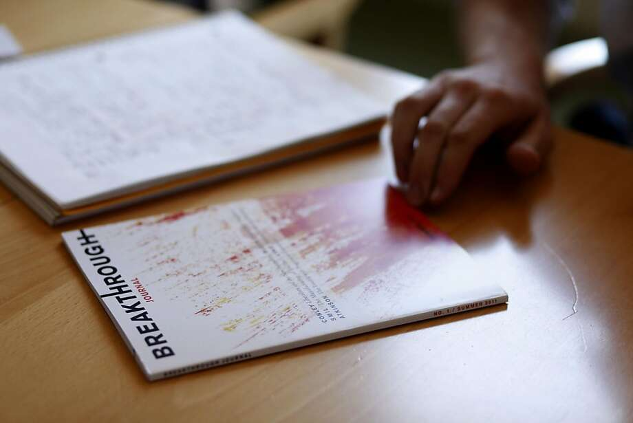 A summer fellow checks a copy of the new Breakthrough Journal, authored by Michael Shellenberger and Ted Nordhaus, on Monday June 15, 2011 in Oakland, Calif. Now they're taking on the entire liberal movement, saying it should abandon Keynesian economics. Photo: Mike Kepka, The Chronicle
