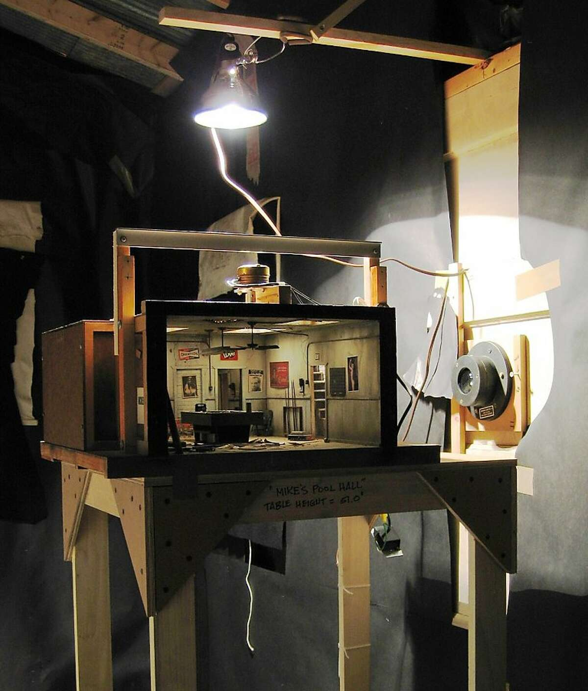 """Installation (side) view of miniature diorama """"Mike's Pool Hall"""" (1977), mixed media, made to be viewed through a security peephole by Michael McMillen"""