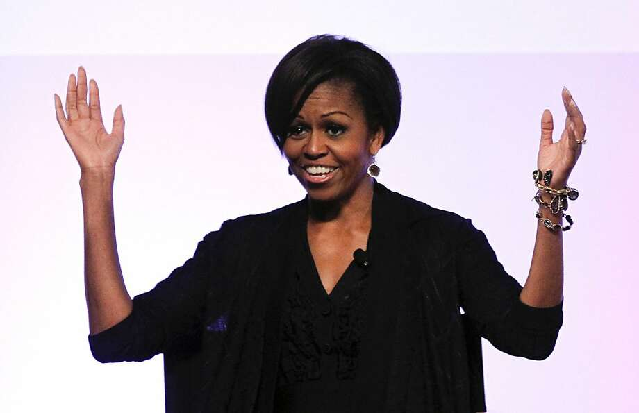 First lady Michelle Obama arrives for a panel discuss hosted by Entertainment Guilds in Beverly Hills, Calif., Monday, June 13, 2011. The Joining Forces event discussed the stories and issues of today's military families so that their experiences can be integrated into film, television and digital media. Photo: Chris Carlson, AP