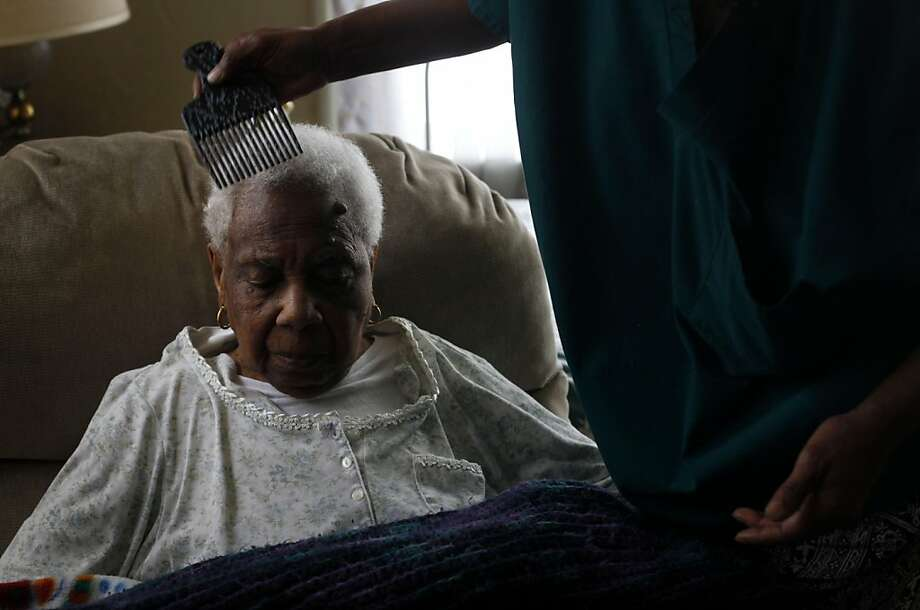 Two days before her 100th birthday, sitting her Berkeley home, Civil rights activist and former Berkeley city councilwoman Maudelle Shirek has her hair done by her niece Deborah Brown on Thursday June 17, 2011 in Berkeley, Calif. Photo: Mike Kepka, The Chronicle