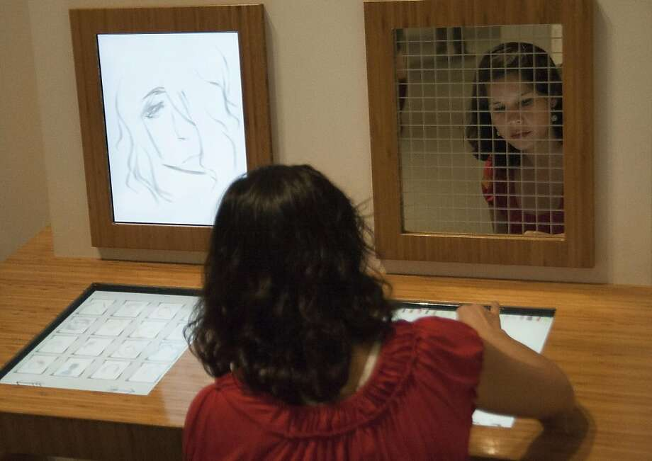 Carolina Martinez interacts with a drawing pad at the Oakalnd Museum of California in Oakland, Calif., on Wednesday, June 8, 2011. Photo: Thomas Levinson, Special To The Chronicle