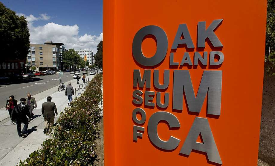 A larger sign on the corner of Oak and 10th Streets marks the newly restored Oakland Museum of California. Photo: Michael Macor, The Chronicle