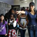 Assistant Director Catalina Castillo positions extras appearing in a music video for Disney Channel actress Zendaya Coleman in Oakland, Calif. on Saturday, June 4, 2011. The music video, produced at the Oakland School for the Arts, was financed entirely by the singer's family.