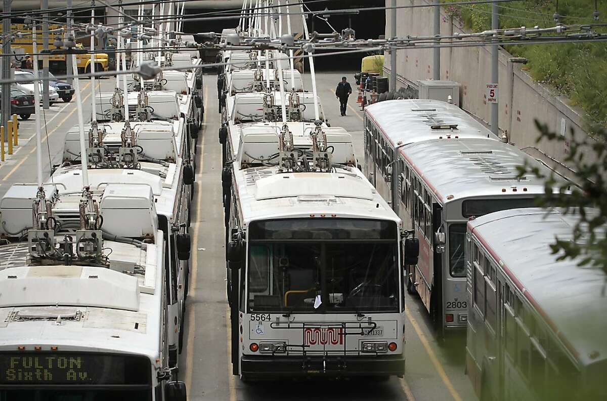 A bus driver walks toward a bus in the Muni maintenance yard. San Francisco Municipal Transit operators vote on ratification of a new contract in San Francisco, Calif., on June 8th, 2011.