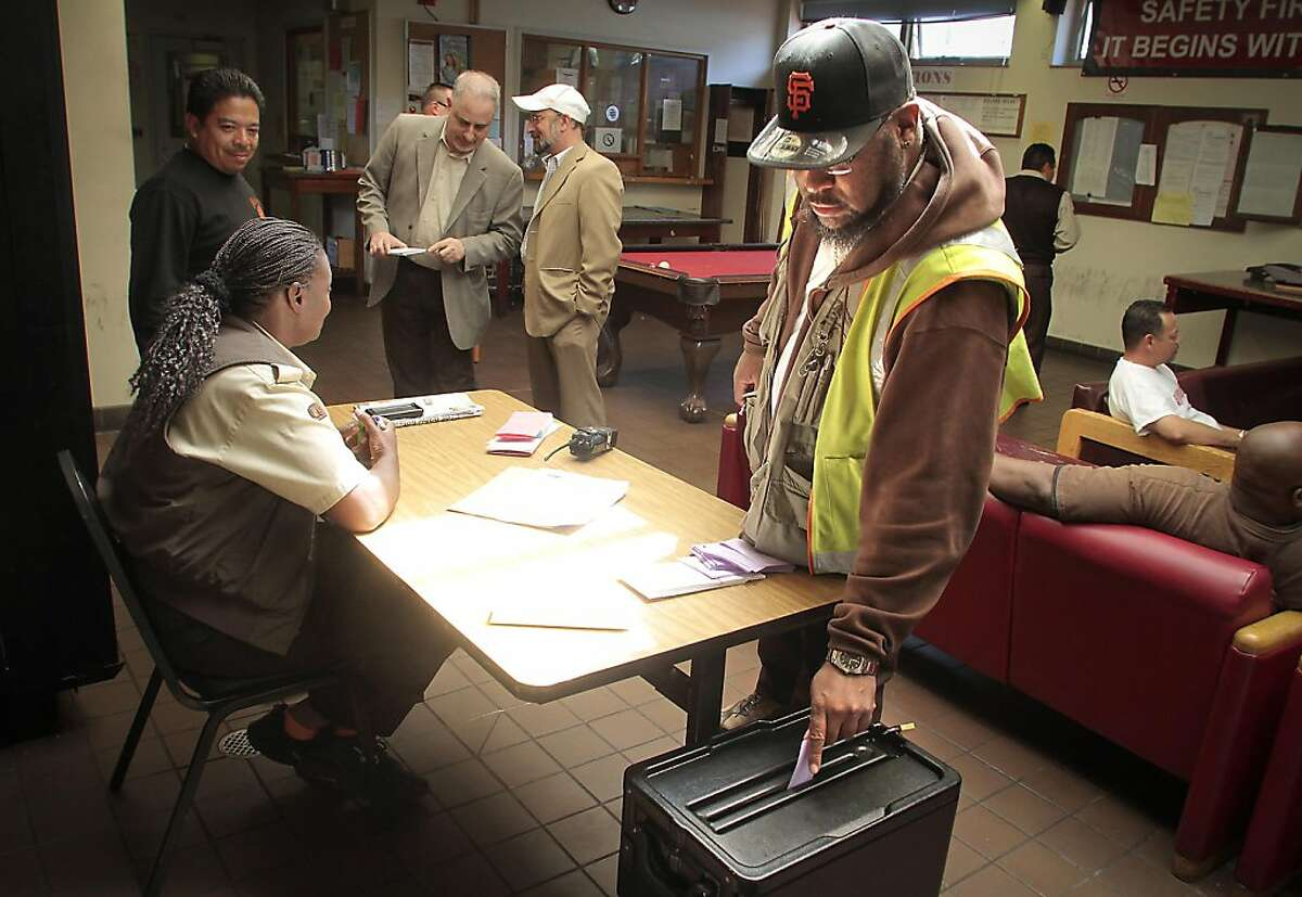 Cale Car operator Tsombe Wolfe puts his vote in the ballot box at the Cable Car barn. San Francisco Municipal Transit operators vote on ratification of a new contract in San Francisco, Calif., on May 8th, 2011.