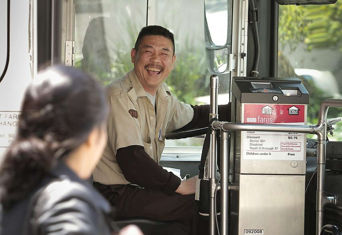 A Muni bus driver has a laugh with a rider at Geary and Masonic. San Francisco Municipal Transit operators vote on ratification of a new contract in San Francisco, Calif., on May 8th, 2011.