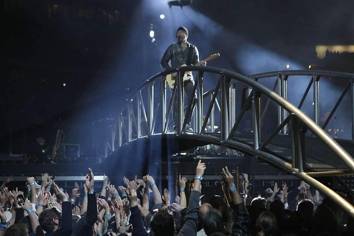 Having been the guitarist, keyboardist and backing vocalist in the Dublin Ireland rock group U2 since the group's inception, David Howell Evans, or the Edge, feels right at home above a sea of fans. U2 played its makeup date of the U2360 degrees world tour in Oakland Calif., June 7, 2011.