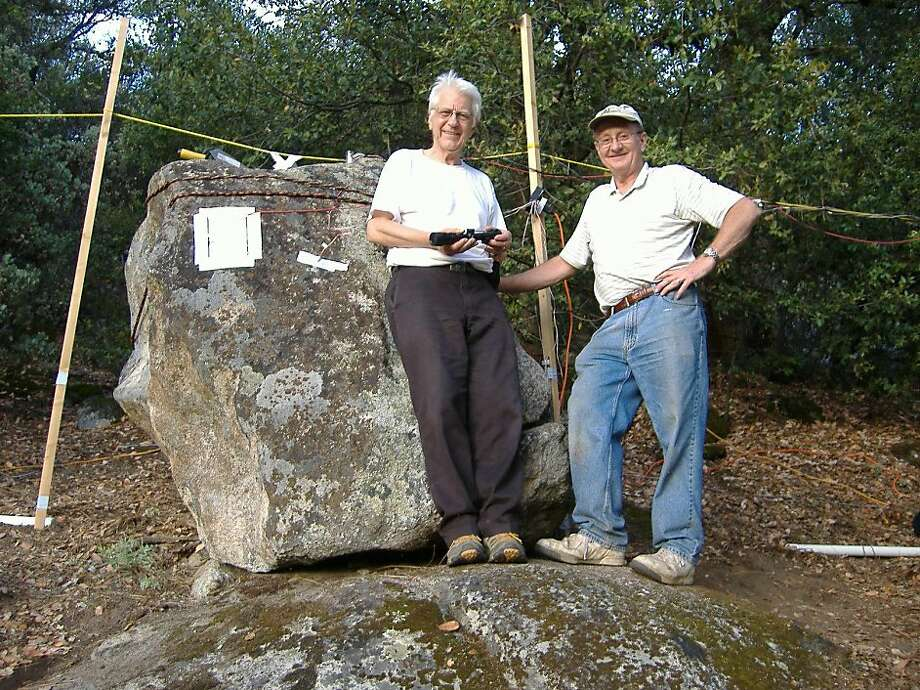 Earthquake researchers Friedemann Freund (left), a NASA scientist, and Tom Bleier, an aerospeace engineer and founder of QuakeFinder, a Palo Alto company trying to predict earthquakes, experimented with finding electromagnetic signals by fracturing this 8-ton boulder near Yosemite. Photo: Bob Dahlgren, Special To The Chronicle