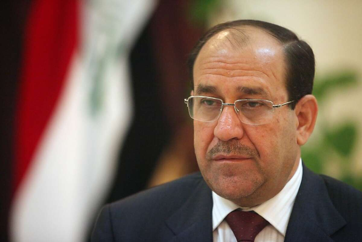 FILE - In this Feb. 28, 2010 file photo, Iraq's Prime Minister Nouri al-Maliki is seen during an interview with The Associated Press in Baghdad, Iraq. Iraqi state TV reports Saturday Feb. 5, 2011 that Prime Minister Nouri al-Maliki won't run for a third term in 2014. Saturday's announcement came a day after the premier's decision to return half his annual pay to the government treasury to ease disparities between rich and poor Iraqis. That move appeared calculated to insulate al-Maliki from the anti-government unrest spreading across the Middle East. (AP Photo/ Khalid Mohammed, File)