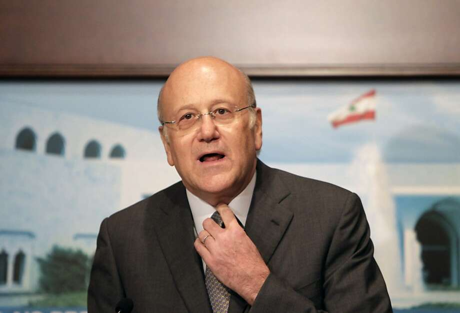 Lebanon's prime minister-designate Najib Mikati adjusts his necktie prior to delivering a speech announcing the formation of a new 30-member cabinet in which the powerful militant group Hezbollah and its allies hold the majority, at the presidential palace of Baabda, east of Beirut on June 13, 2011. Photo: Joseph Eid, AFP/Getty Images
