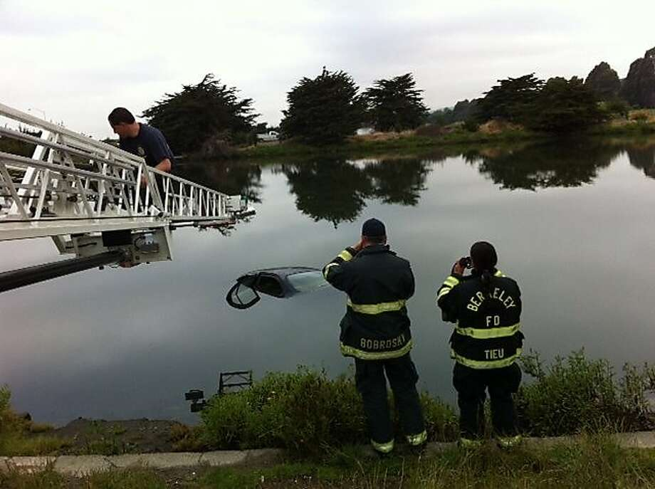 Berkeley firefighters pull a stolen 1995 Nissan Maxima from Aquatic Park on June 7, 2011. Photo: Courtesy Berkeley Police