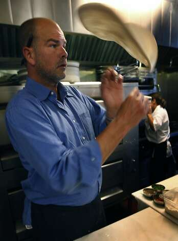 Christian Caiazzo, chef/owner of Osteria Stellina, spins dough for a pizza crust in Point Reyes Station, Calif., on Friday, June 11, 2010. Caiazzo also owns and operates the coffee bar at Toby's Feed Barn across the street. Photo: Paul Chinn, The Chronicle