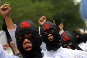 Muslim activists attend a rally for youths to swear to die in retaliation for the death of Osama bin Laden in Solo, Central Java on May 6, 2010.  About one hundred people took part in a religious oath to declare themselves ready to die as a martyrs following the killing of Al-Qaeda leader Osama bin laden.