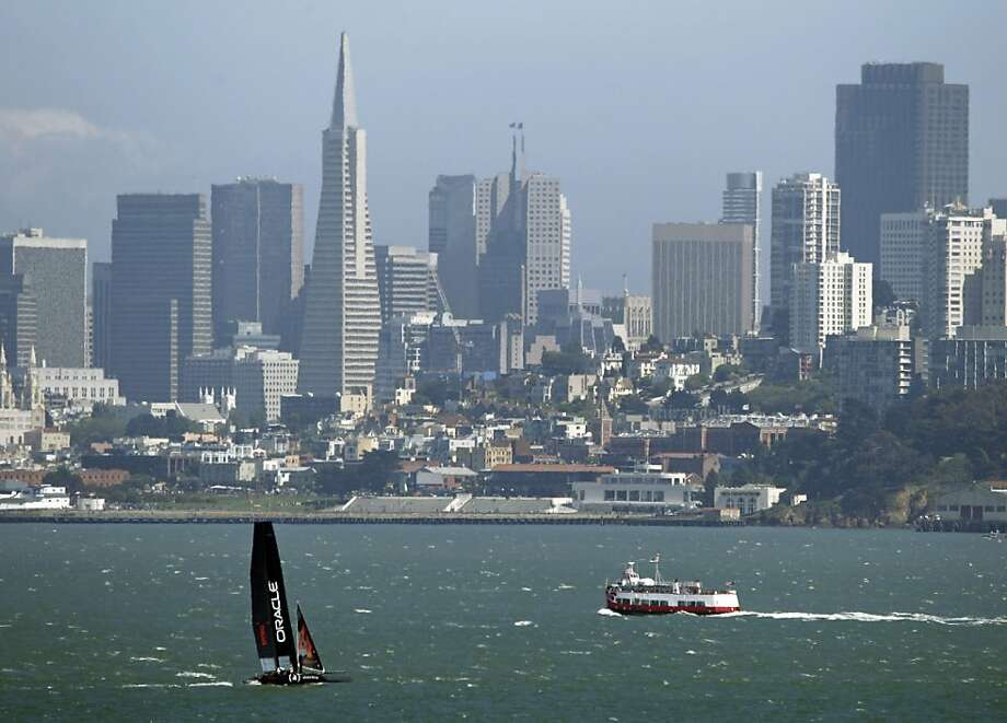 An Oracle Racing AC45, skippered by James Spithill, makes its way past a cruise boat and the San Francisco skyline in this view from Sausalito, Calif., Monday, June 13, 2011. The forerunner to the AC72--which teams will race in the Louis Vuitton Cup and America's Cup finals in 2013 in San Francisco--the AC45 will be featured at the AC World Series this year and next. Photo: Eric Risberg, AP