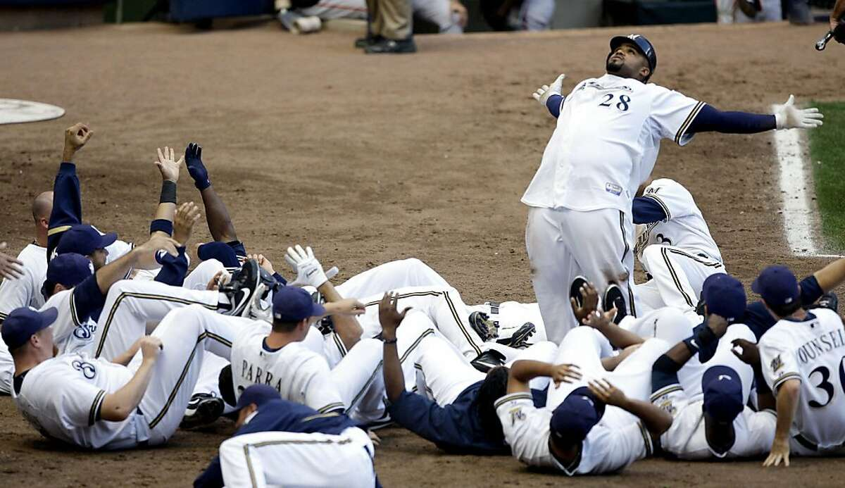 Milwaukee Brewers' Prince Fielder (28) reacts at home with teammates after hitting a walk-off home run during the 12th inning of a baseball game against the San Francisco Giants Sunday, Sept. 6, 2009, in Milwaukee. The Brewers won 2-1.
