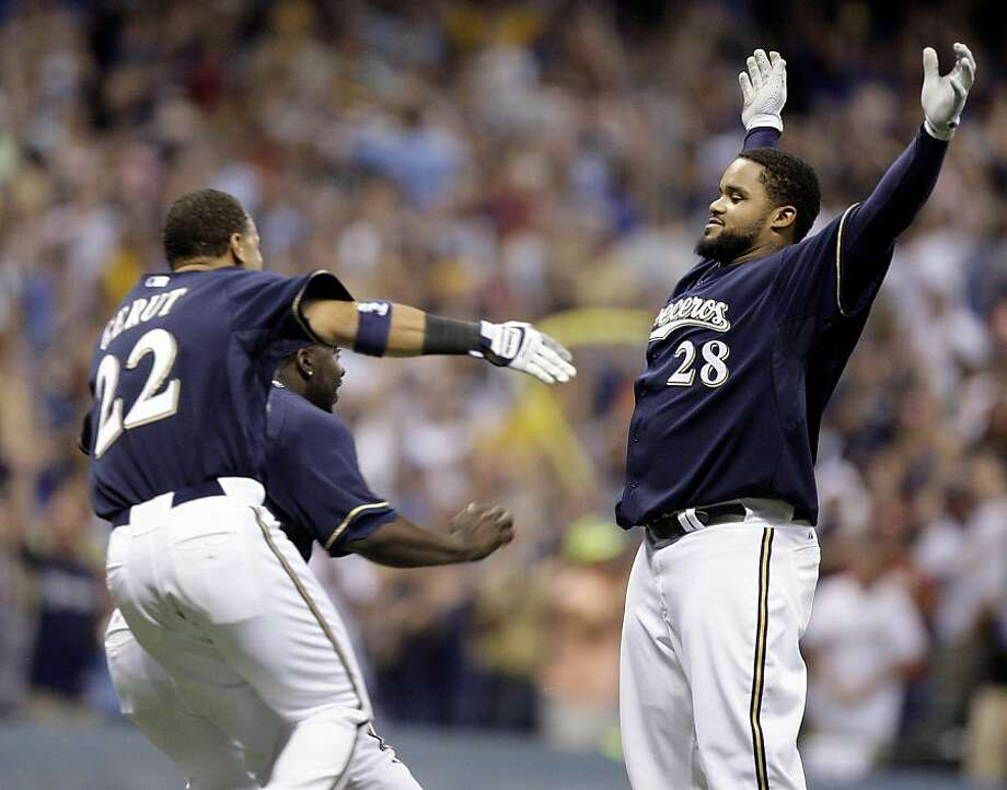 Milwaukee Brewers' Prince Fielder (28) waits to get congratulated by teammates Jody Gerut (22) and Bill Hall after hitting a game-winning hit during the ninth inning of a baseball game against the San Francisco Giants Saturday, June 27, 2009, in Milwaukee. The Brewers won 7-6. Photo: Morry Gash, AP