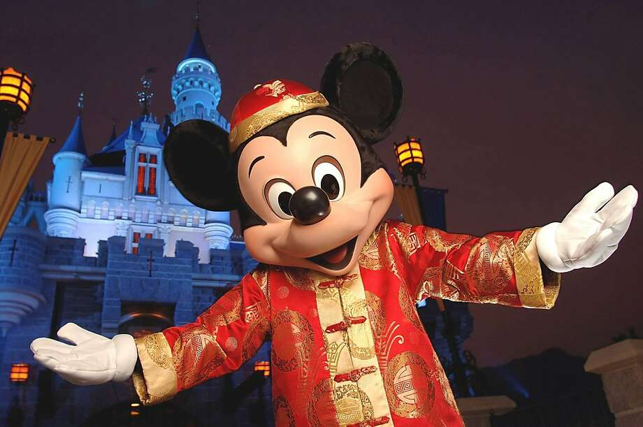 In this image released by Hong Kong Disneyland, Mickey Mouse clad in traditional Chinese dress poses in front of Sleeping Beauty Castle inside Hong Kong Disneyland Park Thursday, Sept. 1, 2005. Hong Kong Disneyland Resort, consisting of a theme park, two Disney hotels and a lakeside recreation area, is scheduled to open Sept. 12, 2005. It is Disney's first-ever vacation resort in China.(AP Photo/Hong Kong Disney Land, Mark Ashman, HO) ** Photo: Mark Ashman, AP