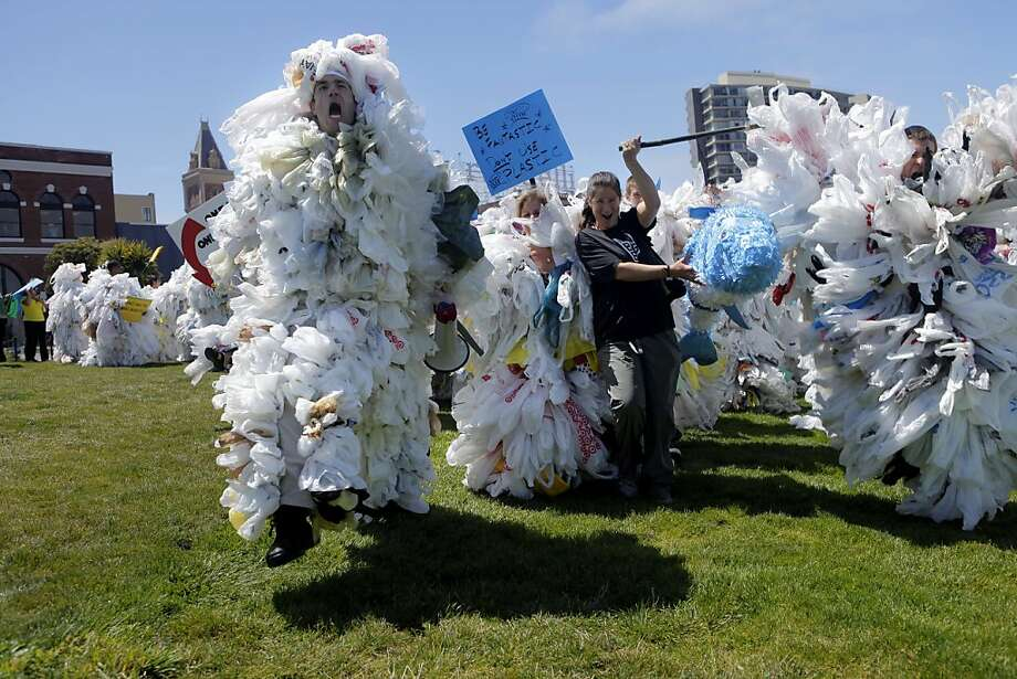 Andy Keller, left  lead approximately 60 people dressed as bag monsters down Aquatic Park, Thursday August 12, 2010, in San Francisco, Calif. They were supporters of  California Bill AB1998,  which if passed would make California the first in history the prohibit plastic bags in markets statewide. Photo: Lacy Atkins, The Chronicle