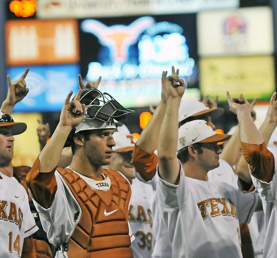 "Texas players give the Texas ""hook em horns"" sign during the school song after defeating Arizona State in Game 3 of the NCAA Super Regional college baseball tournament, Sunday, June 12, 2011, in Austin, Texas. Knebel got the save in the 4-2 Texas win. Photo: Michael Thomas, AP"