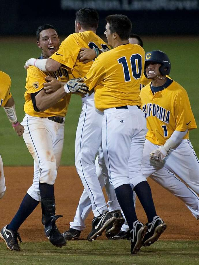 California's Devon Rodriguez, left, is mobbed after his game winning hit during the ninth inning of an NCAA regional college baseball game against Baylor, Monday, June 6, 2011, in Houston. Rodriguez's two-run RBI single led California to a 9-8 win over Baylor. Photo: Dave Einsel, AP