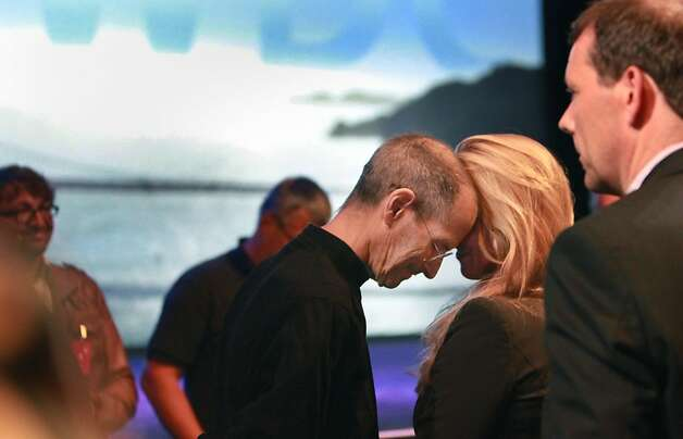 by Lea Suzuki, Steve Jobs rests his head against his wife, Laurene Powell Jobs, after delivering the keynote address to the Apple Worldwide Developers Conference at Moscone West on Monday. Photo: Lea Suzuki, The Chronicle