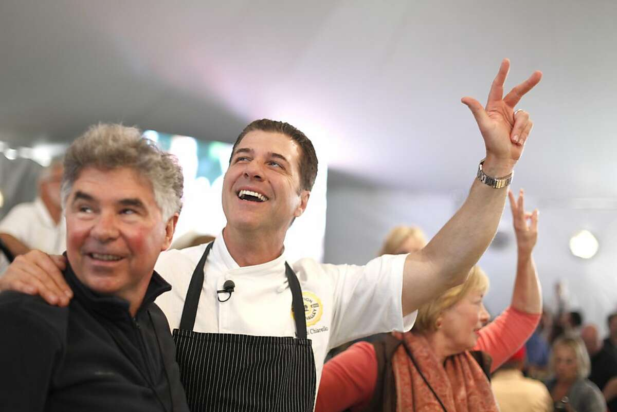 Chef Michael Chiarello (middle) anticipate the auction sale of his Lot #10 at the Napa Valley Auction and the Napa Vintners' annual charity gala at Meadowood in St. Helena, California, on Saturday, June 4, 2011. Garen Staglin is at the left.