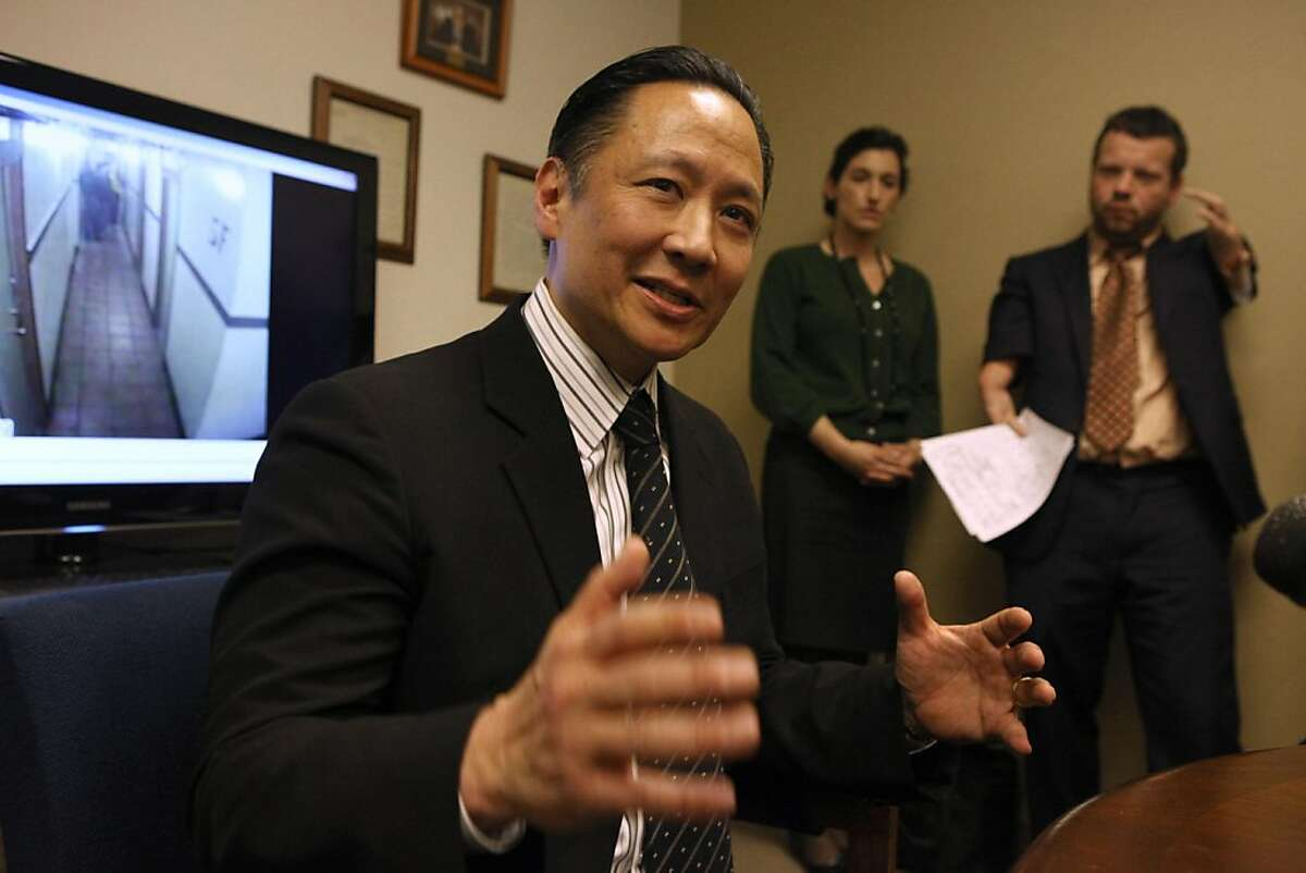 Head of the public defender's office Jeff Adachi shows videos standing in direct contradiction to police reports which were signed by officers under penalty of perjury at the public defender's office in San Francisco, Calif., on Tuesday, March 1, 2011. Surveillance video from the Henry Hotel reveals that SFPD narcotics officers falsified police reports in order to justify searching residences without warrants or consent.