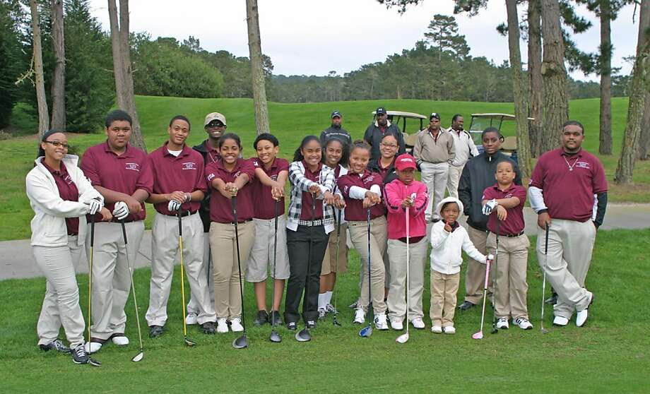 Youth from Friendship Baptist Church, located in Seaside, who are participating in the Friendship Golf Academy, stand for a portrait on the Poppy Hills golf course in Pebble Beach after finishing the clinic program, a 20 week long training offered free of charge to youth who would not have access to golf courses otherwise. Photo: Photo Courtesy Of The NCGA Found