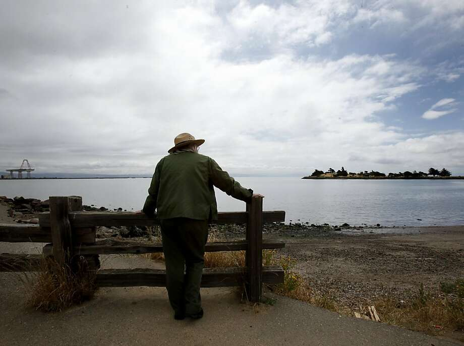 In this file photo, state Park ranger Ann Meneguzzi looked out over Candlestick Point. A car plunged into the bay near the point on Sunday, but no one was found in the car. Photo: Brant Ward, The Chronicle