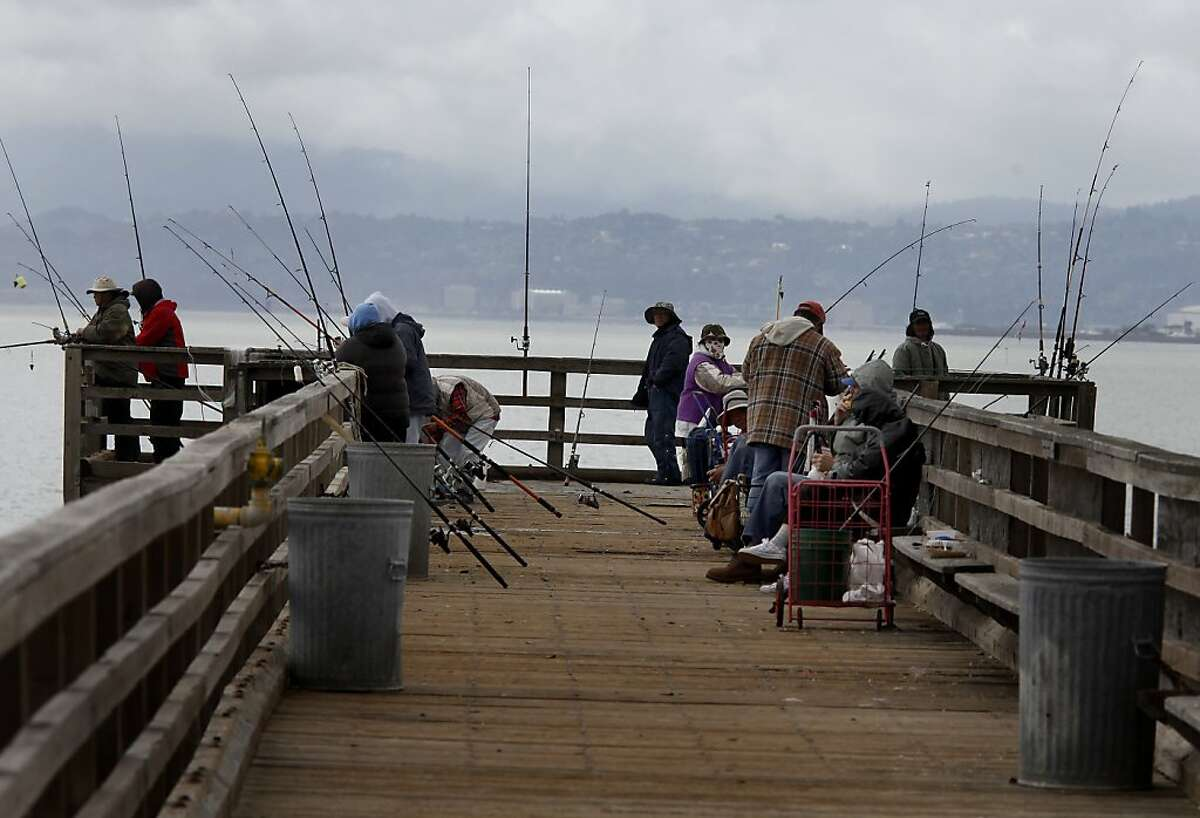 Fisherman crowd the public pier at Candlestick Point. Proposition 68, a $4 billion bond measure on the June 5 ballot, would fund refurbishing rundown park structures, building hiking trials and preserving beach access across the state.