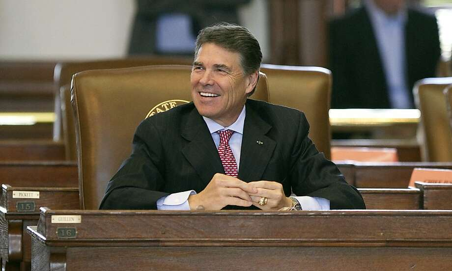 Gov. Rick Perry smiles during the investiture of Judge Elsa Alcala to the Texas Court of Criminal Appeals in the House of Representatives on Friday, June 10, 2011 in Austin. Photo: Larry Kolvoord, AP