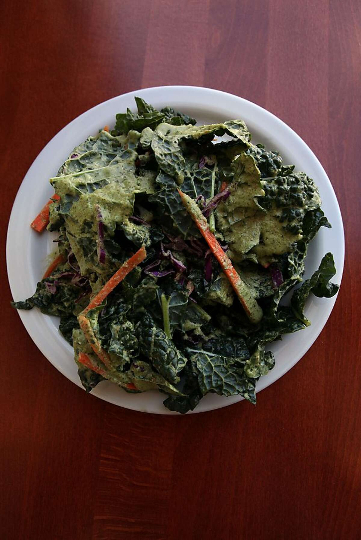 Living Green Goddess salad-- dino kale, carrot, sesame seeds, red cabbage with green goddess dressing-- from Source in San Francisco, Calif., on Friday, May 6.