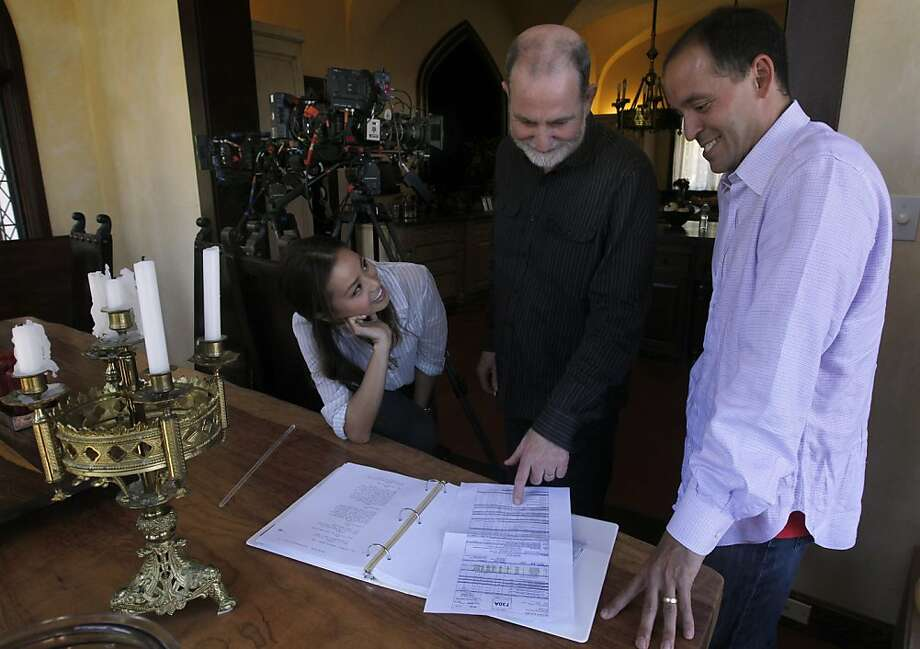 "Actress Jamie Chung, director Bill Guttentag and screenwriter Chris Lehane review a script before filming a scene for the movie ""Knife Fight"" in Los Altos Hills, Calif. on Tuesday, June 7, 2011. The film, written by the well-known local political consultant Lehane and scheduled to be released next year, is a dramatized look at the inside workings of a political campaign. Photo: Paul Chinn, The Chronicle"