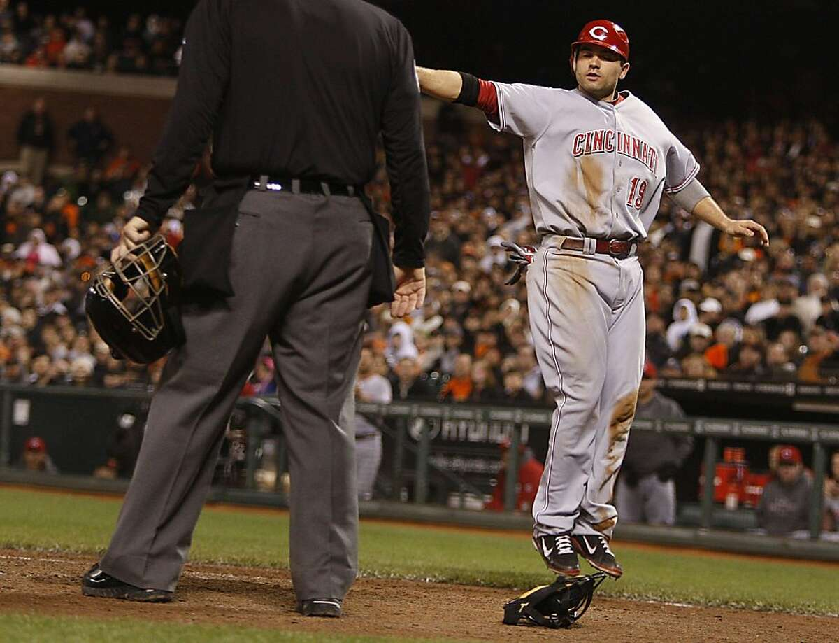 Cincinnati Red Joey Votto scores at home plate during the eighth inning at AT&T Park in San Francisco, Calif., for one of three points winning the game against the Giants 3-0 on Thursday, June 9, 2011.