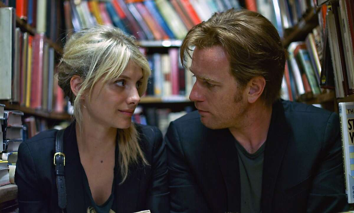 In this film publicity image released by Focus Features, Mélanie Laurent, left, and Ewan McGregor are shown in a scene from