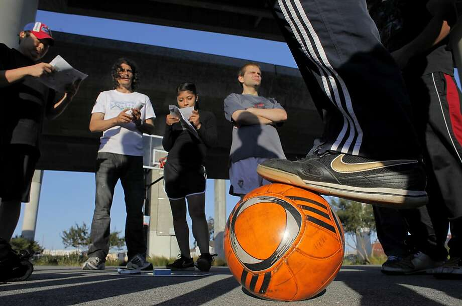 Soccer players listen to coach Antoine Lagarde about team strategy during practice, Tuesday June 7, 2011, in San Francisco, Calif. The Street Soccer USA is a national program that is operated out of the St. Vincent de Paul homeless shelter. The team will be traveling to Washington D.C. to play in the Street Soccer USA Cup 2011, over the weekend. Photo: Lacy Atkins, The Chronicle