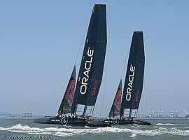 Oracle Racing's America's Cup catamarans spar on Thursday near Alameda in preparation for test races starting Monday. The name Coutts on the mainsail refers to four-time America's Cup winning skipper, Olympic gold medalist, and Oracle Racing CEO Sir Russell Coutts. Spithill refers to Jimmy Spithill, who skippered last year's America's Cup win.