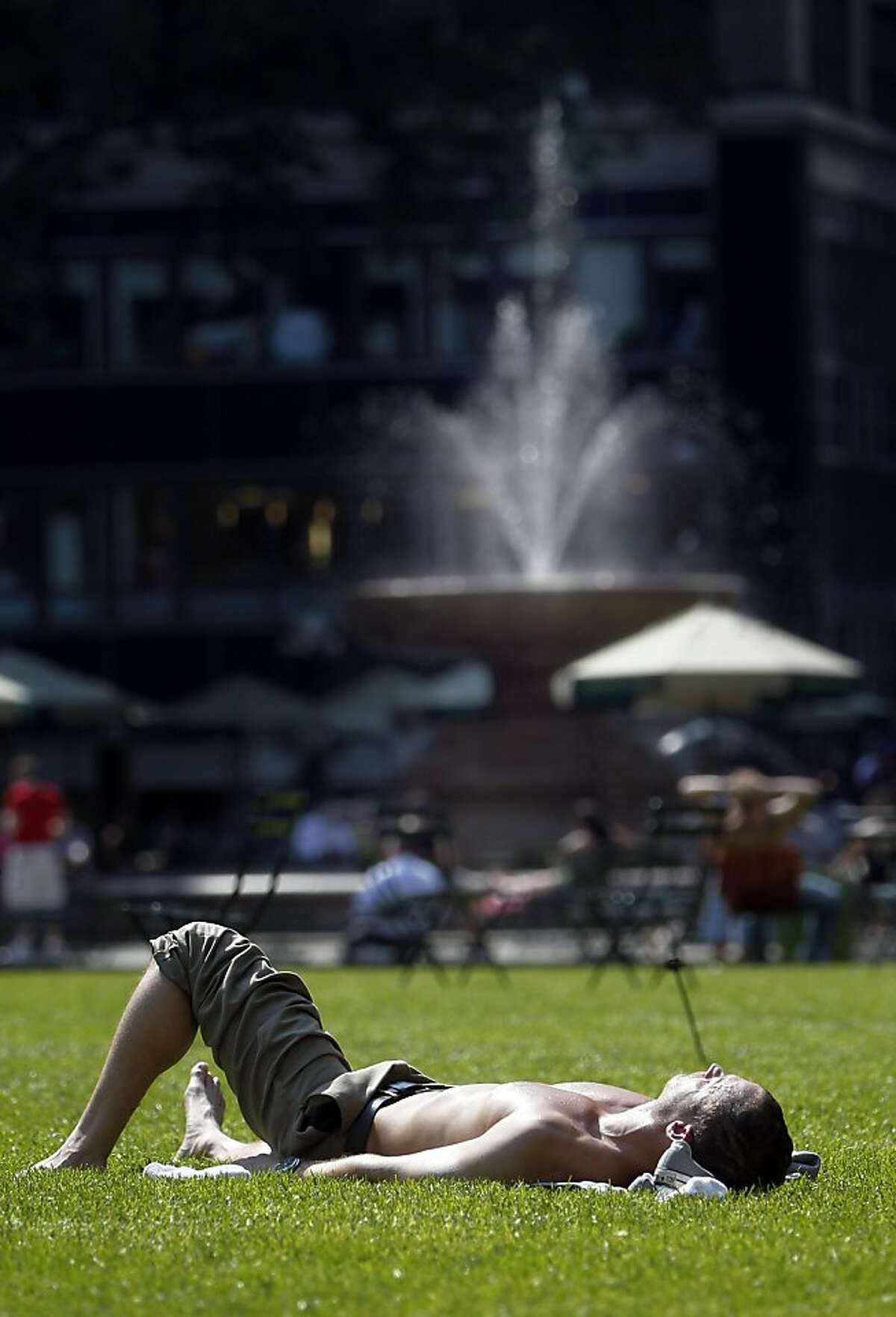 A sunbather basks in the hot sun of Bryant Park, Wednesday, June 8, 2011 in New York. Temperatures are expected to rise well in to the 90's Wednesday as New York braces for a possible heat wave, its first of the season.