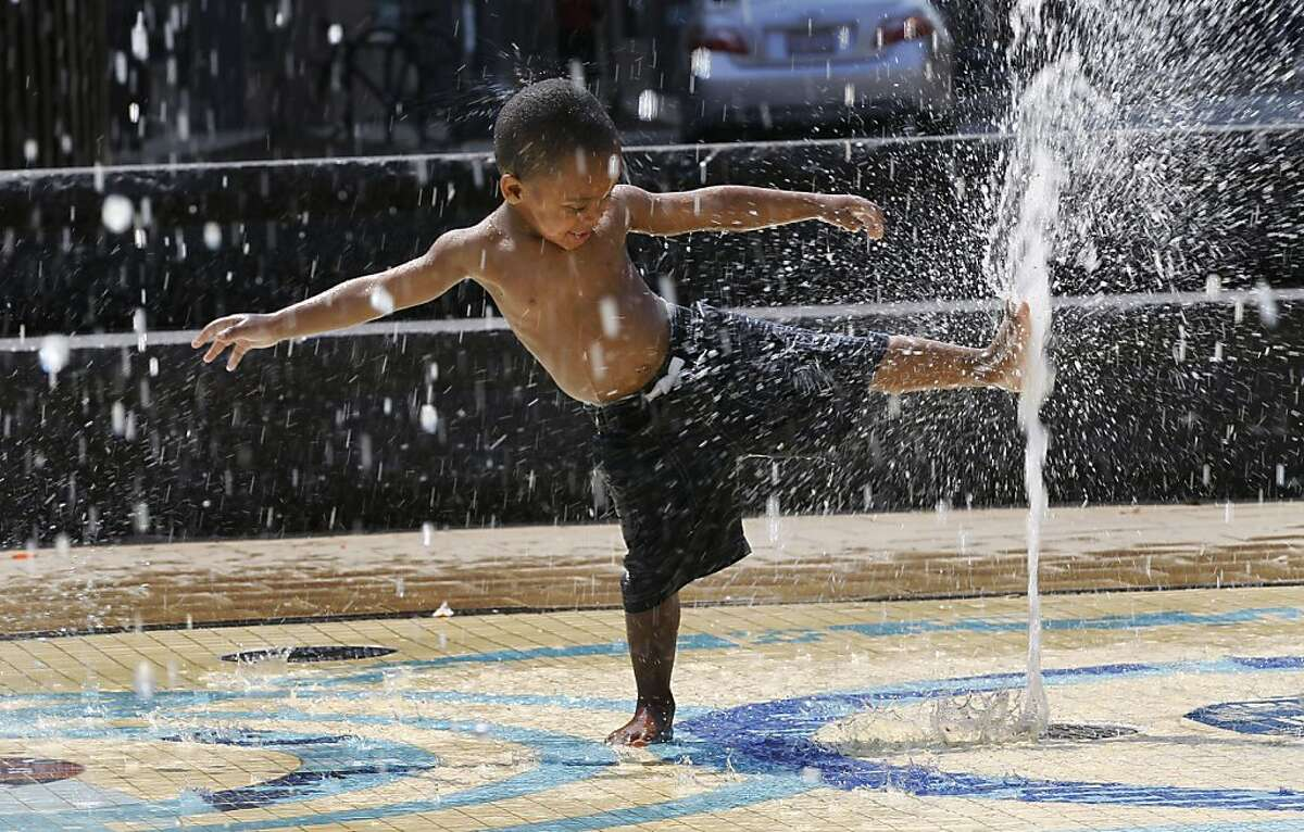 Damien Sheffield, 2, plays in a water fountain in Washington, Wednesday, June 8, 2011. The official start of summer is still two weeks away, but much of the nation is sweating through near-record temperatures, with heat advisories and warnings issued across the Northeast, mid-Atlantic and upper Midwest.