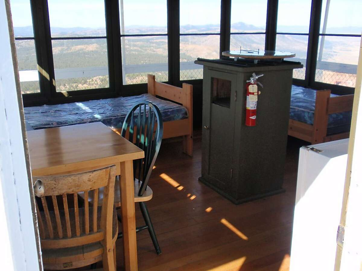 The Black Mountain lookout comes with two beds and big windows all around.