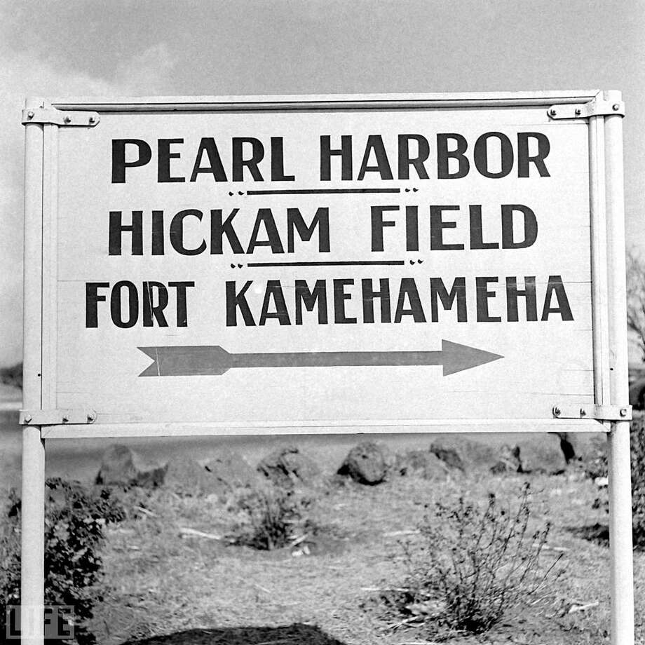 "President Franklin Roosevelt declared December 7, 1941 -- when Japan launched more than 350 fighters, bombers, and torpedo planes against the U.S. naval base in Hawaii -- a ""date which will live in infamy."" In fact, that Sunday morning 70 years ago is so seared into America's memory that the tumult of the weeks and months afterward, as the U.S. responded to the attack, is often overlooked. Here, on the 70th anniversary of Pearl Harbor, LIFE.com presents rare and unpublished photos from Hawaii and the mainland, chronicling a nation's answer to an unprecedented act of war.Above: A sign points the way to Pearl Harbor on December 15, 1941, a week after the attack. Photo: William C. Shrout/TIME & LIFE Pictures/LIFE.com"