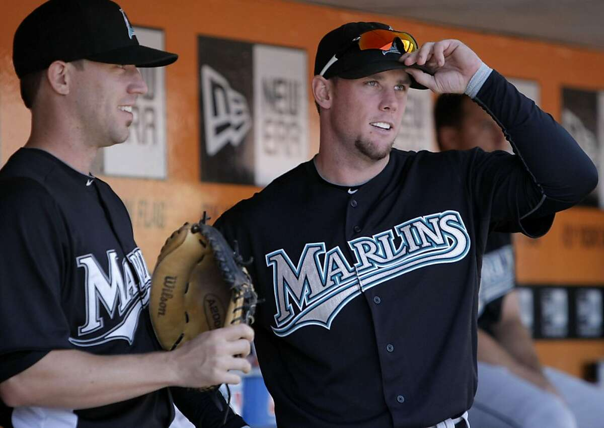 Florida Marlins' Scott Cousins (33) (center) talks with Brett Hayes (9) as the San Francisco Giants take on the Florida Marlins at AT&T Park in San Francisco, Calif., on Thursday, May 26, 2011.