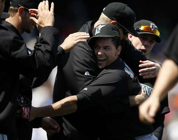 Florida Marlins' Anibal Sanchez (19) gets congratulated by teammates after the San Francisco Giants take on the Florida Marlins at AT&T Park in San Francisco, Calif., on Thursday, May 26, 2011. Photo: Thomas Levinson, The Chronicle
