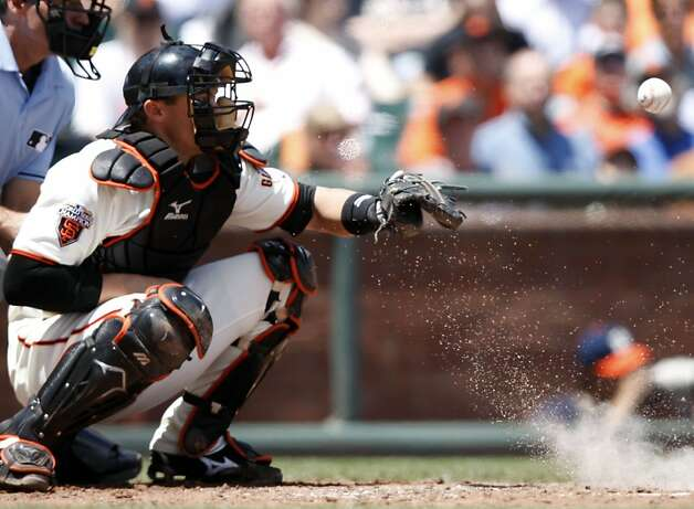 San Francisco Giants' Eli Whiteside watches a foul tip into the dirt as the San Francisco Giants take on the Florida Marlins at AT&T Park in San Francisco, Calif., on Thursday, May 26, 2011. Photo: Thomas Levinson, The Chronicle