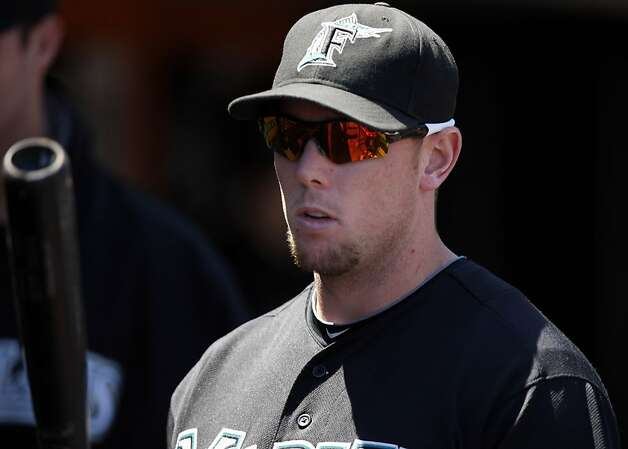 Florida Marlins' Scott Cousins (33) watches from the Marlins' dugout as the San Francisco Giants take on the Florida Marlins at AT&T Park in San Francisco, Calif., on Thursday, May 26, 2011. Photo: Thomas Levinson, The Chronicle