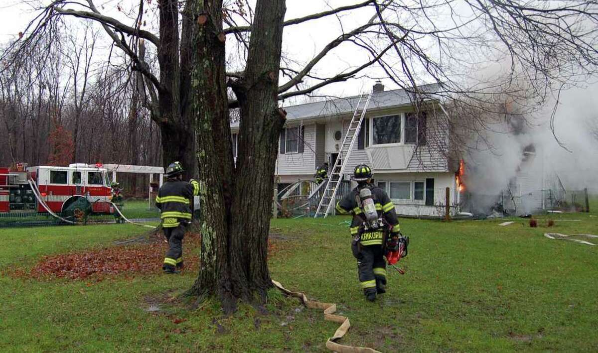 A house fire at 56 Old Ridgebury Road in Danbury this morning, caused electrical and smoke damage inside the house. Photo by Mark Omasta